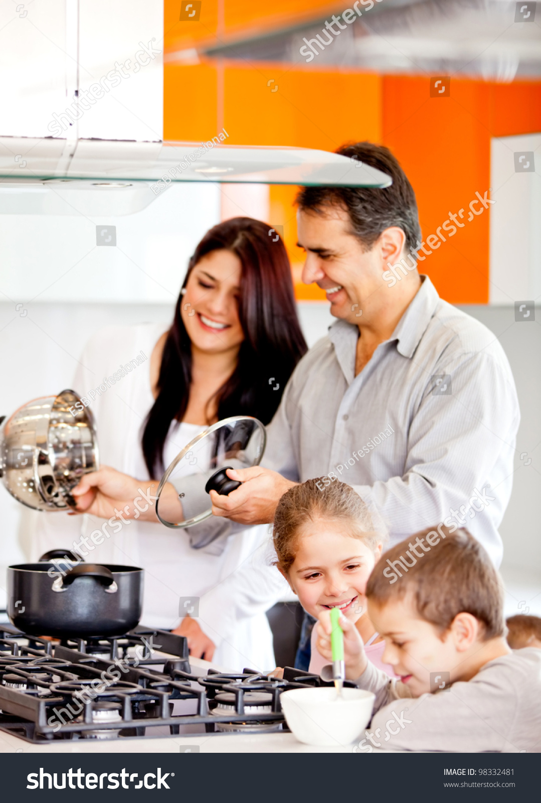 happy family kitchen cooking dinner together stock photo, Kitchen design
