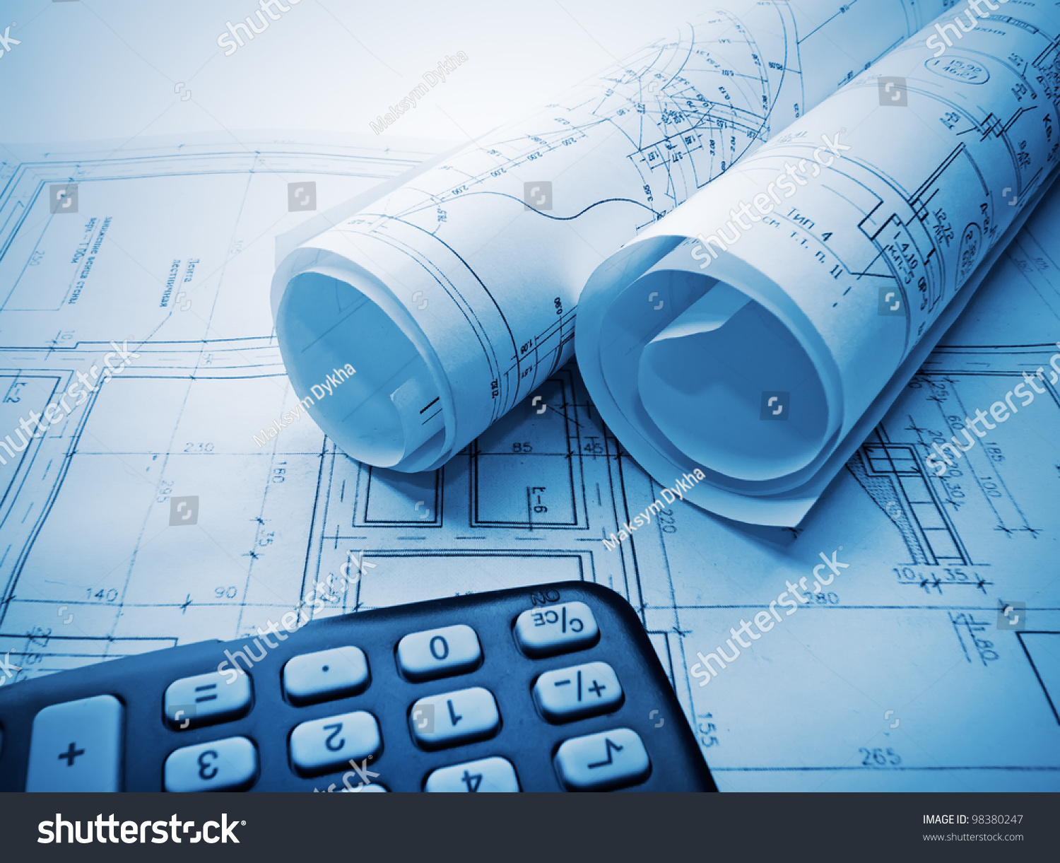 Architectural blueprints rolls calculator stock photo for Blueprint estimator