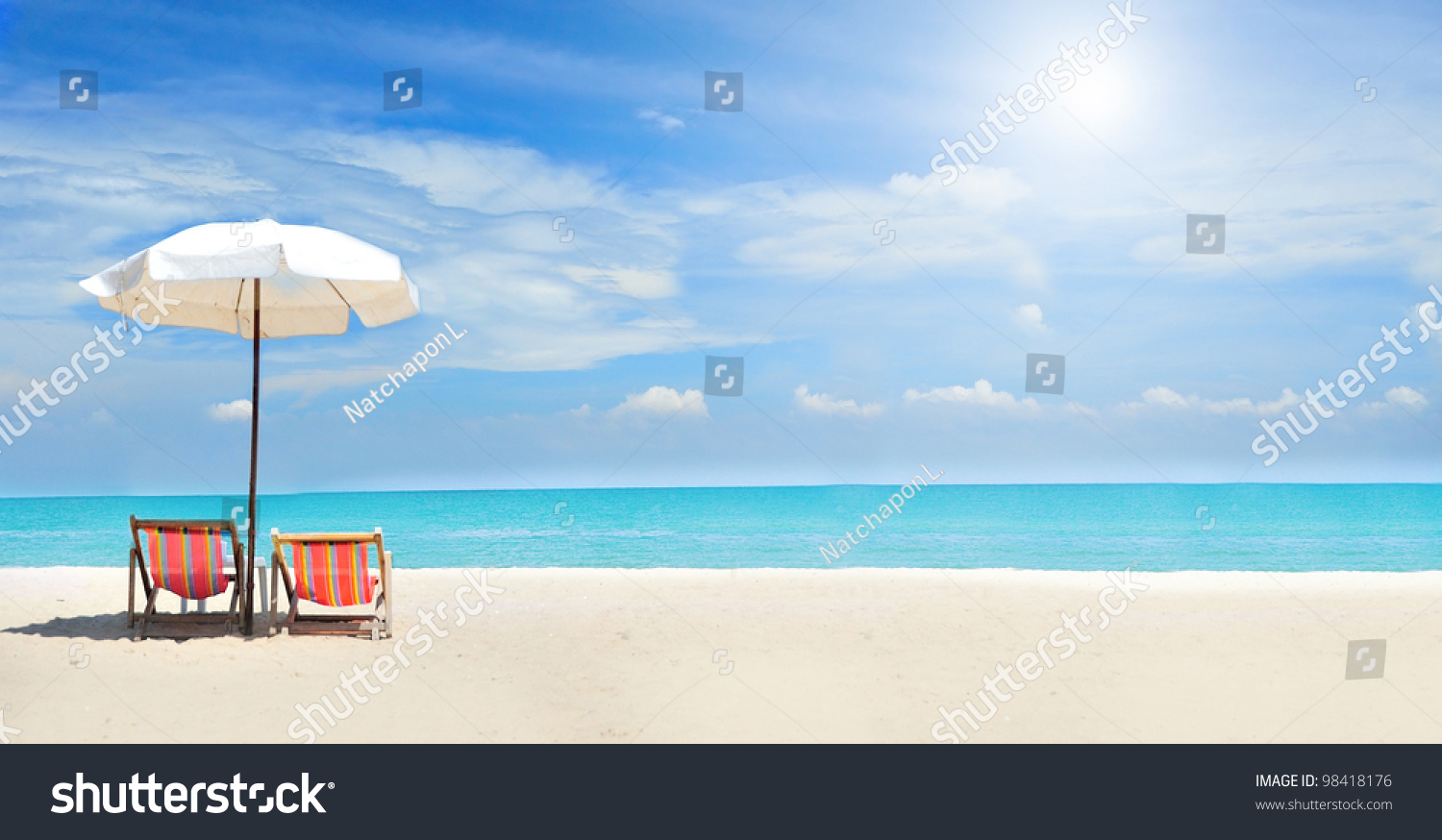 Beach with chairs - Beach Chairs On The White Sand Beach With Cloudy Blue Sky And Sun