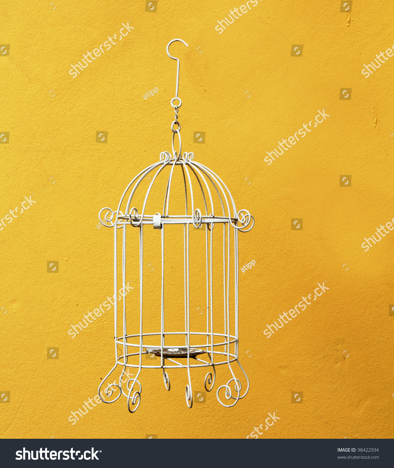 Classic Bird Cage On Yellow Wall Stock Photo Edit Now 98422934