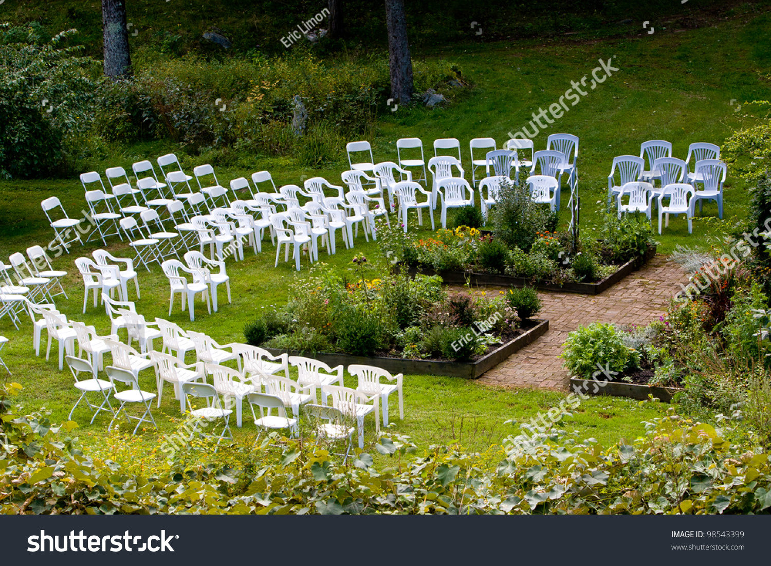 Wood Chairs Outdoor Ceremony: An Area Set Up With Chairs For An Outdoor Wedding Ceremony