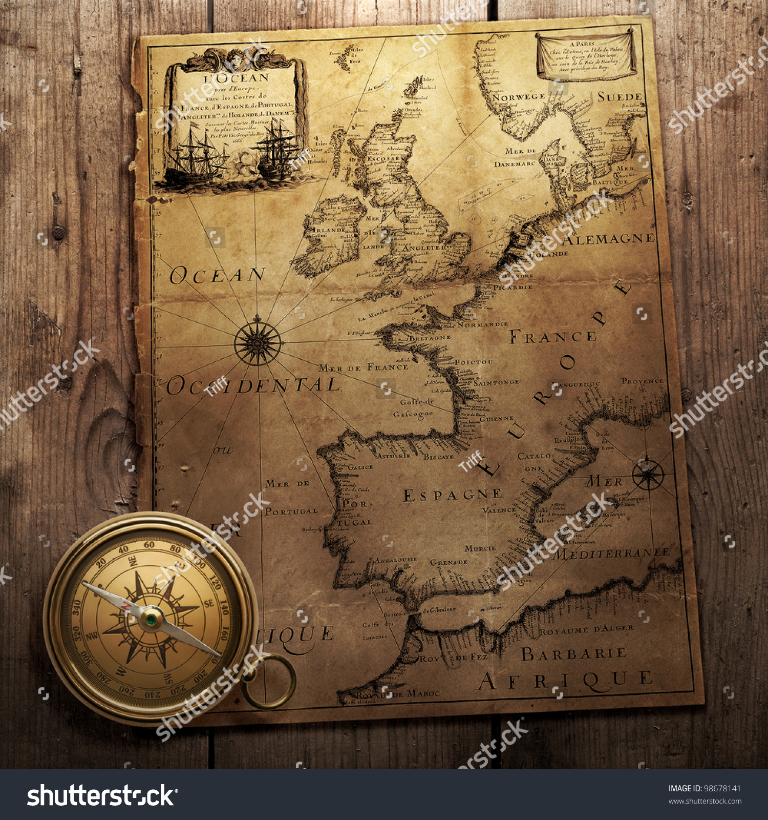 Old compass on vintage map france foto de stock libre de regalas old compass on vintage map france spain england portugal holland gumiabroncs Gallery