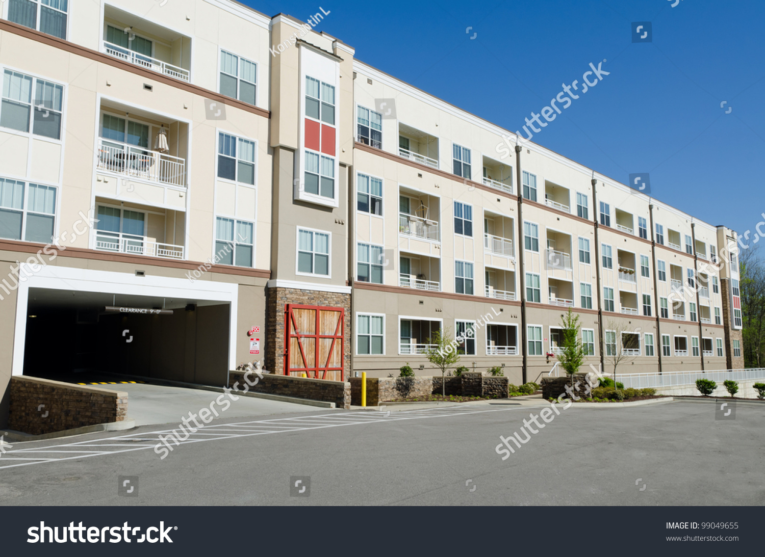Modern Apartment Building With Parking Garage Stock Photo