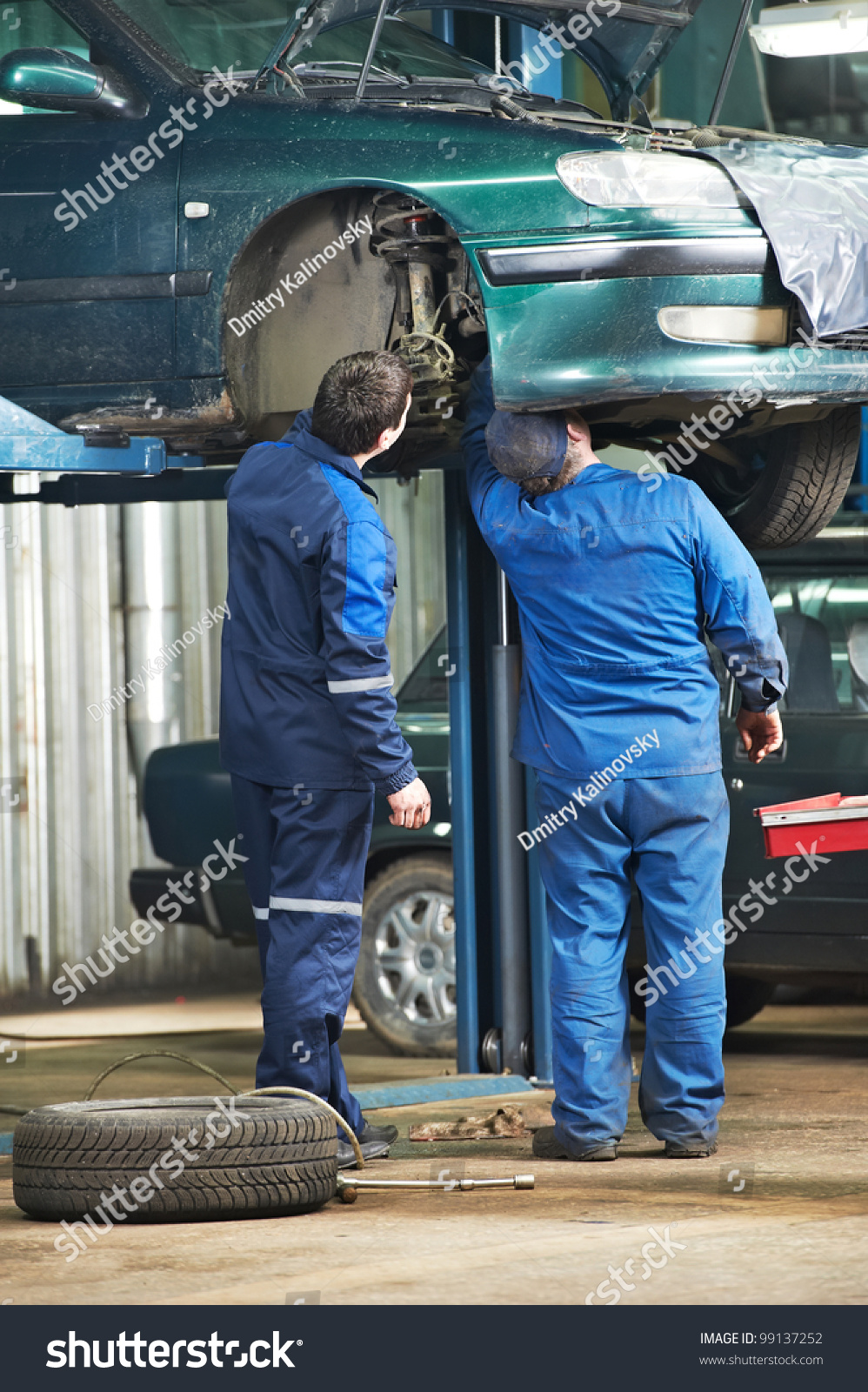 Two Motor Mechanic Diagnosing Automobile Car Stock Photo 99137252