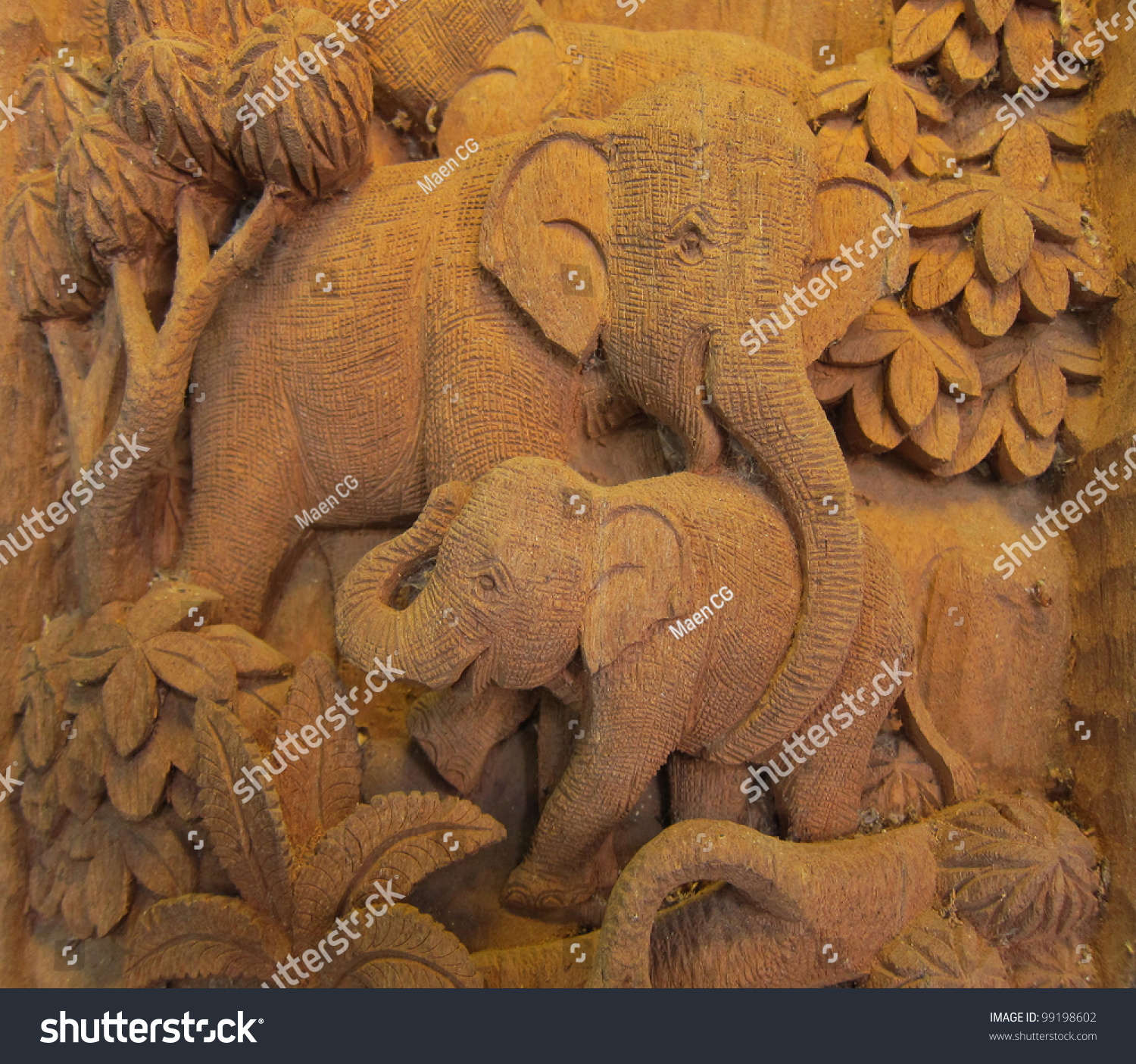 Elephant forest high relief carving sculpture stock photo