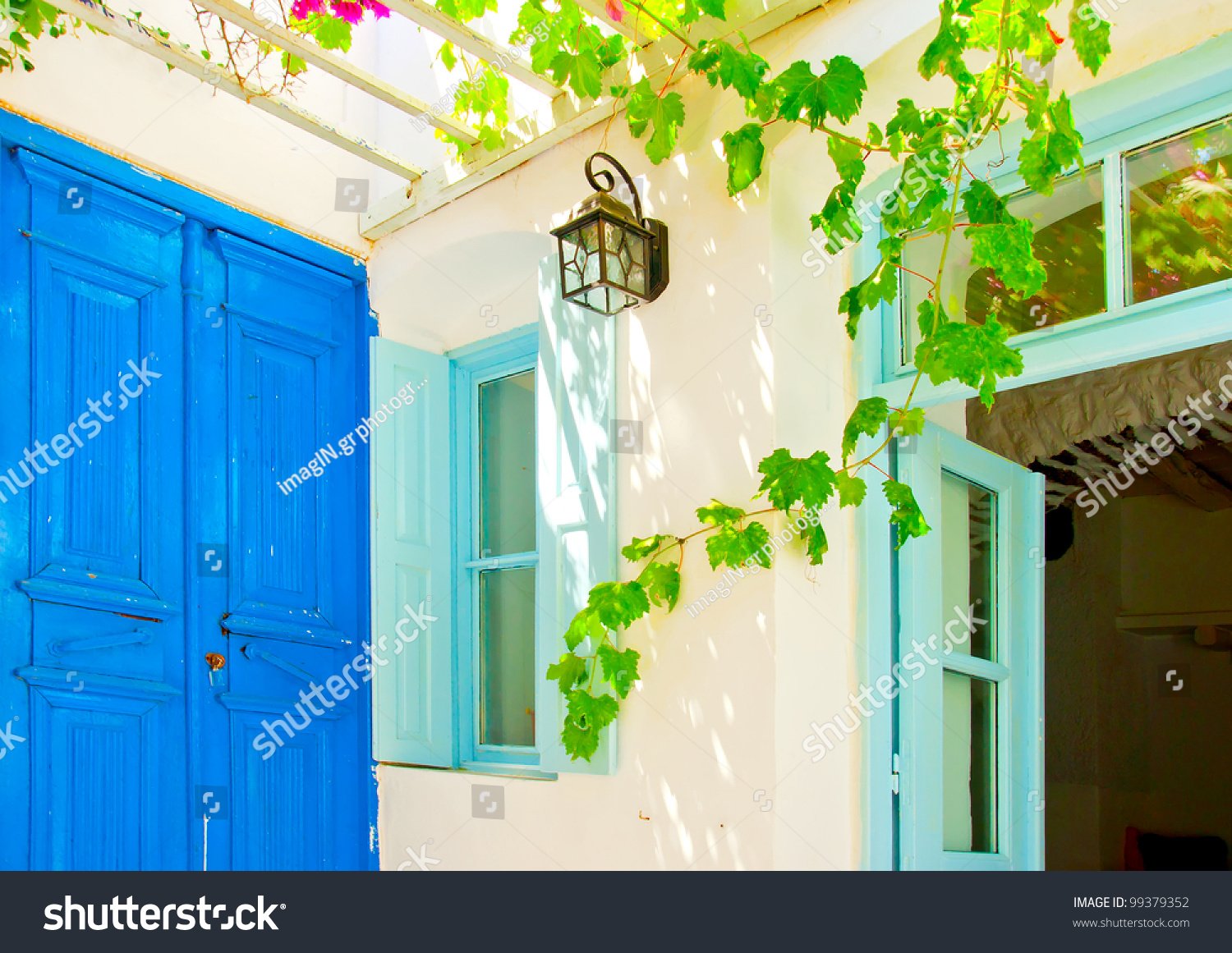 Old beautiful traditional house in chora the capital of amorgos island - A Beautiful Traditional Old House With Pergola And Blue Colored Doors And Windows In Chora The Preview Save To A Lightbox