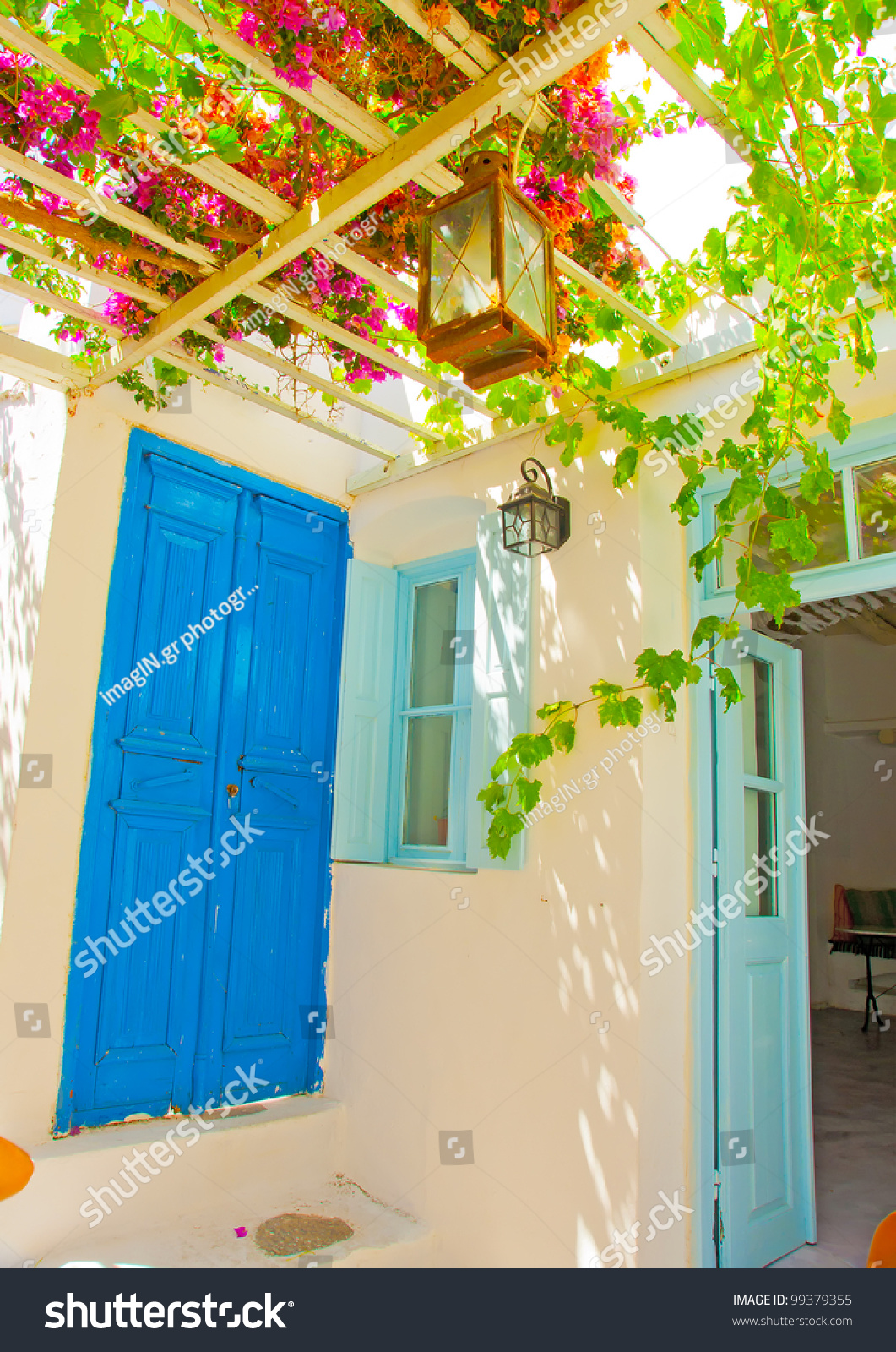 Old beautiful traditional house in chora the capital of amorgos island - A Beautiful Traditional Old House With Pergola And Blue Colored Doors And Windows In Chora The