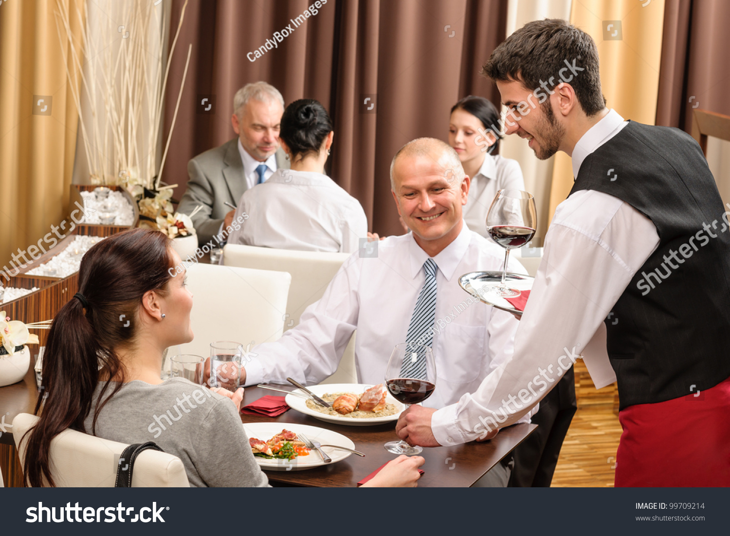 Young Waiter Serve Wine Business People Stock Photo ...