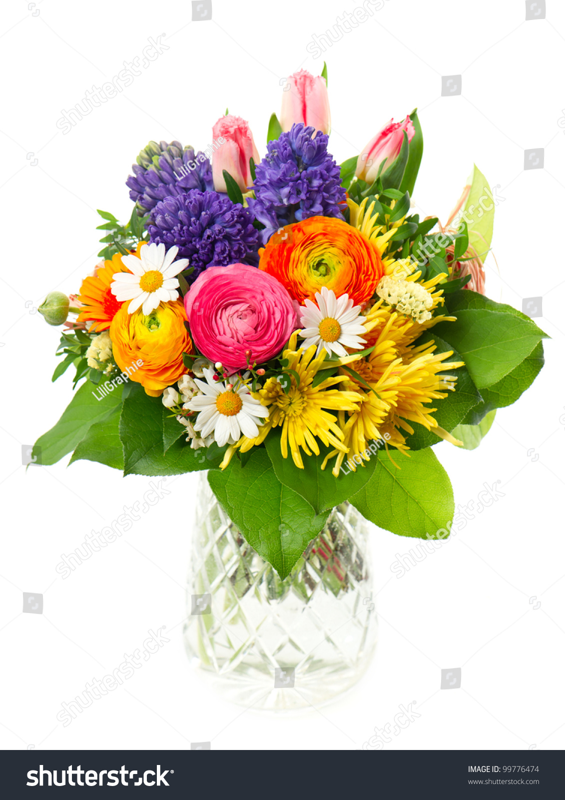 Beautiful bouquet colorful spring flowers glass stock photo beautiful bouquet of colorful spring flowers in a glass vase tulip ranunculus hyacinth dhlflorist Choice Image