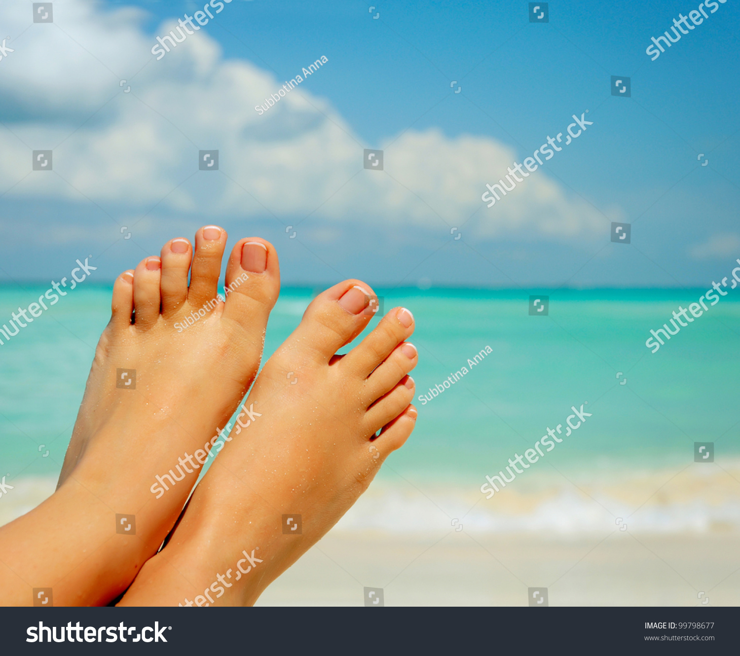 Vacation Concept. Tanning On The Beach. Woman'S Bare Feet
