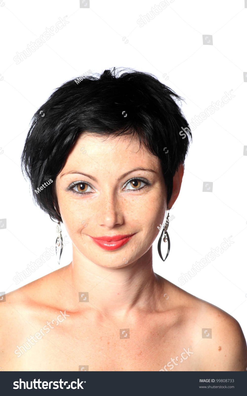 Portrait of a young brunette lady on white background