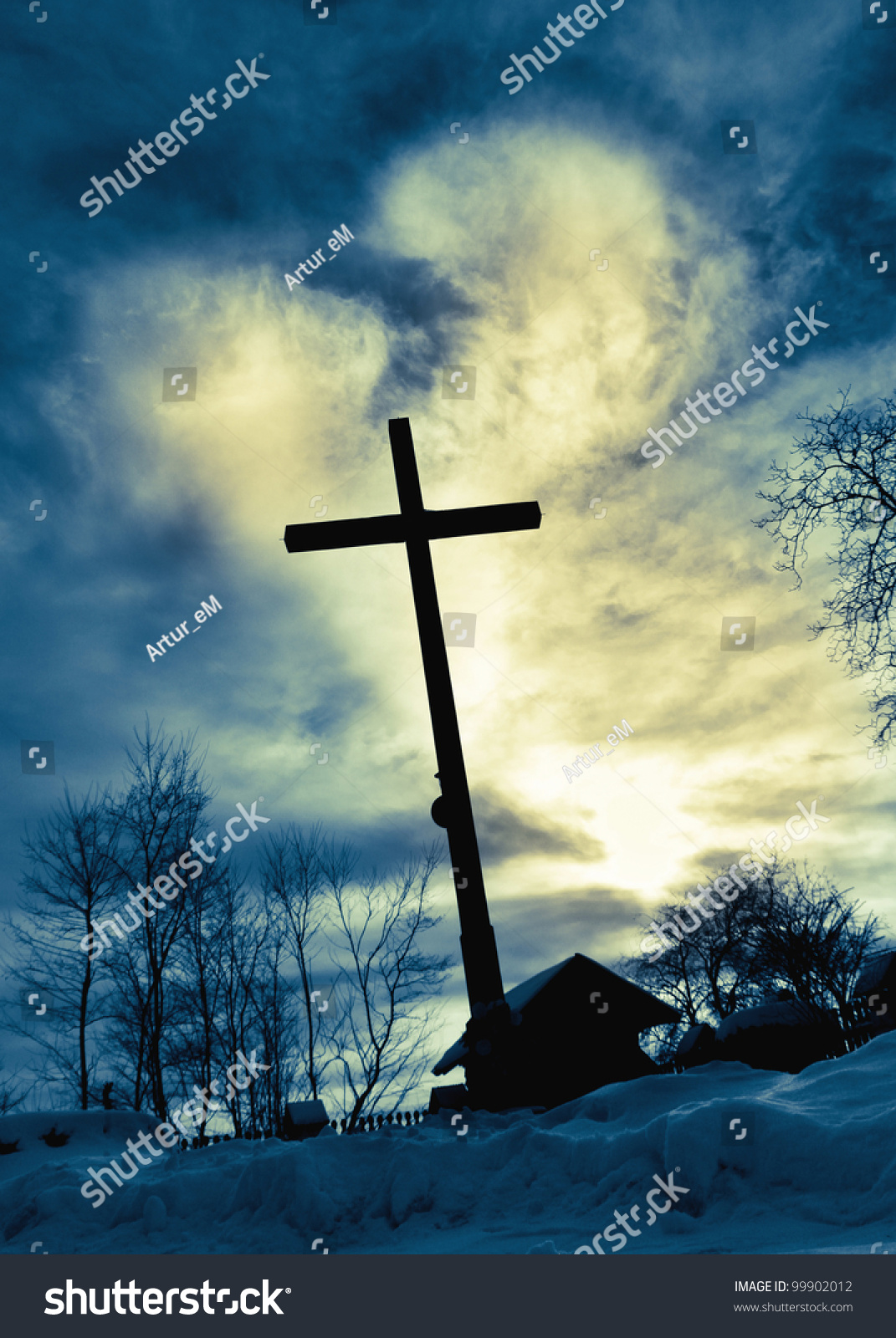Silhouette of the holy cross on background of storm clouds stock - Dramatic Sky Cloud With Deep Blue Heart Shape Shining Behind Jesus Cross