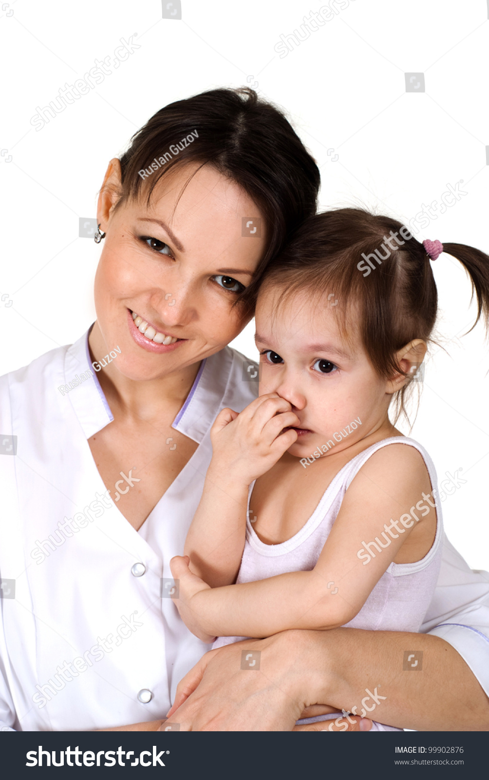 Beautiful Smiling Caucasian Nurse Holding A Baby Girl On A ...