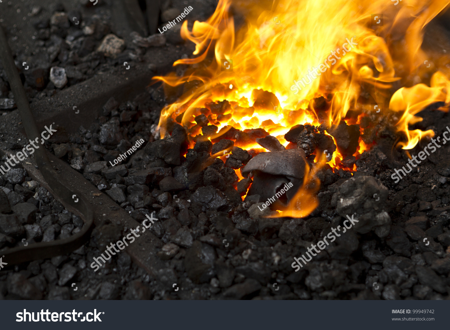 close up of a blacksmith shop fire stock photo 99949742 shutterstock. Black Bedroom Furniture Sets. Home Design Ideas