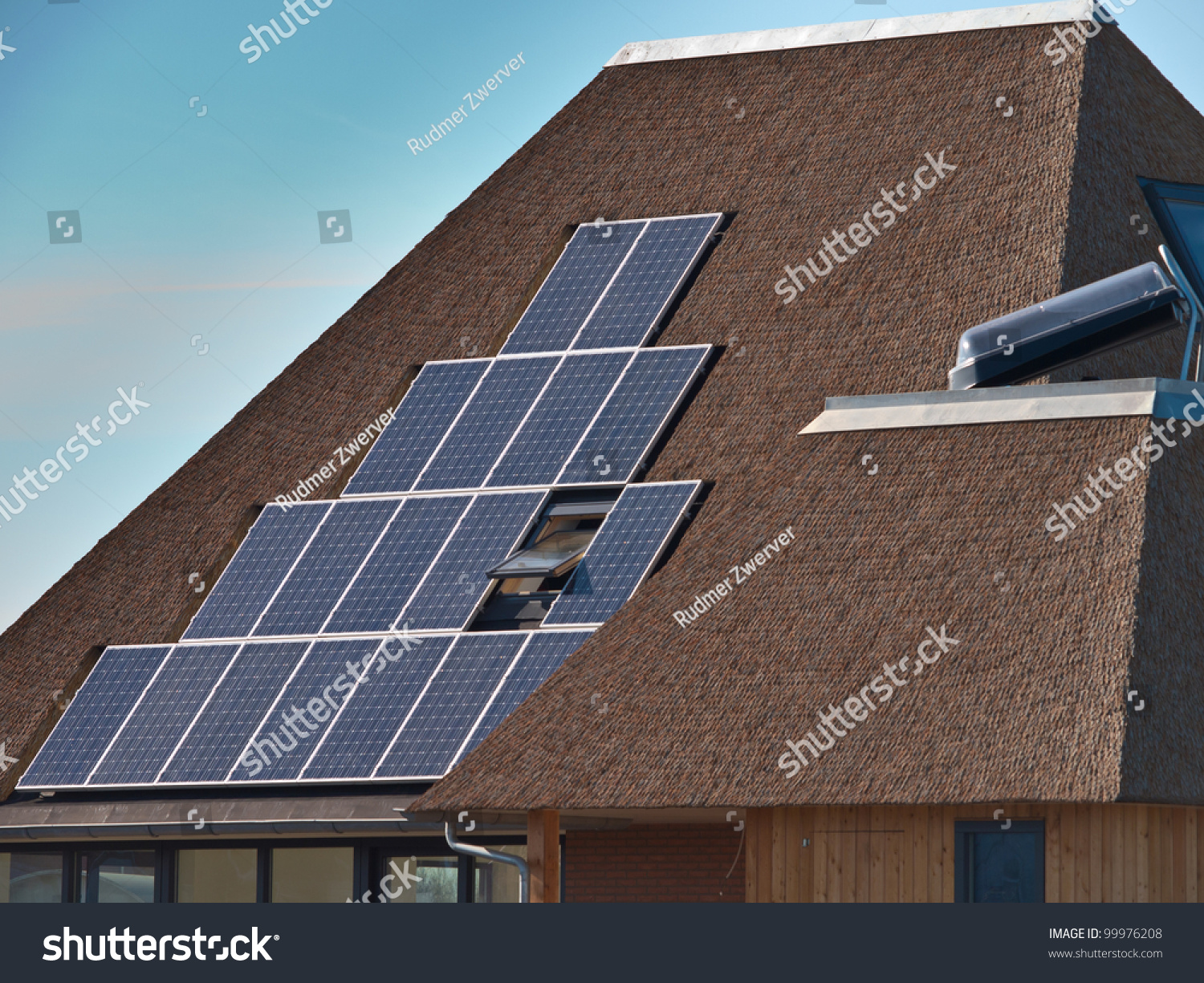 Solar Panels On A Modern House With Thatched Roof Stock