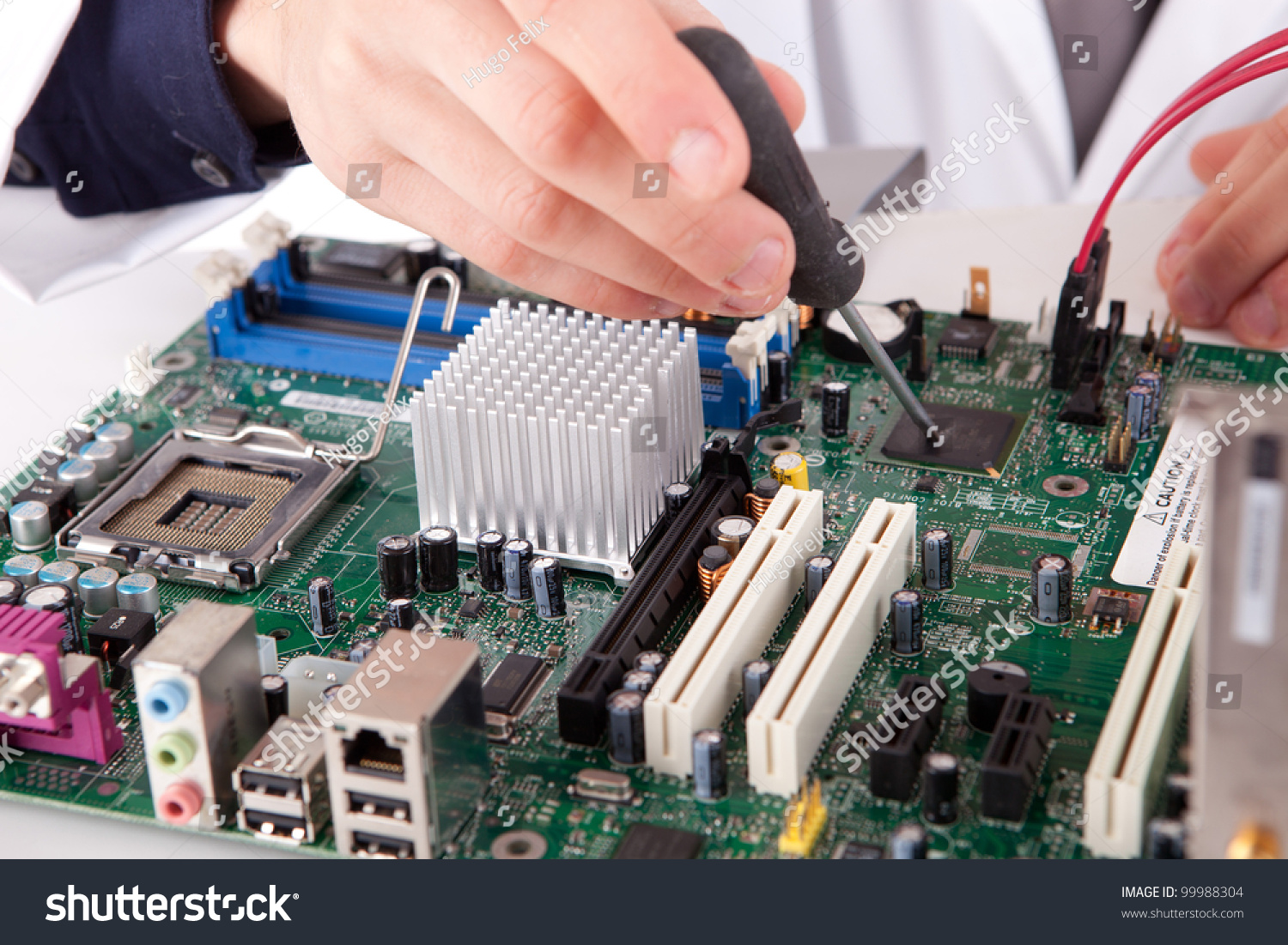 Computer Engineer Working On An Old Motherboard Stock